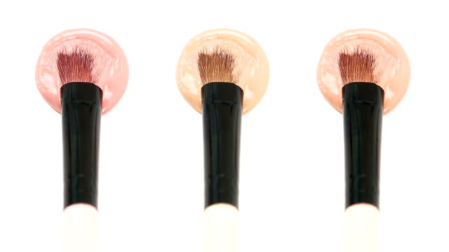foundation Smears of foundation for face.   Cosmetic smear. Isolated on white background. foundation make up stock videos & royalty-free footage