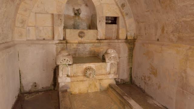 Fountain inside Sehidiye mosque courtyard, Mardin, Turkey Mardin, Turkey - January 2020: Fountain inside Sehidiye mosque courtyard mardin stock videos & royalty-free footage