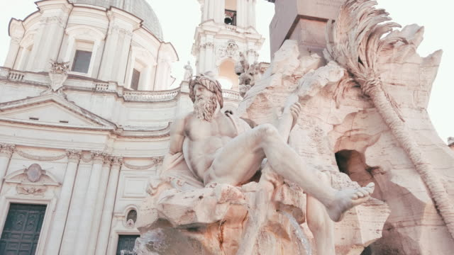 Fountain of the Four Rivers and church of Sant'agnese in Piazza Navona, Rome, Italy