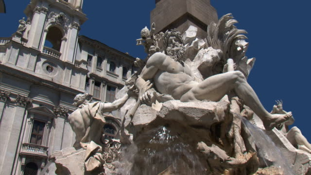 fountain of the rivers by bernini in navona square, rome - renaissance architecture stock videos & royalty-free footage