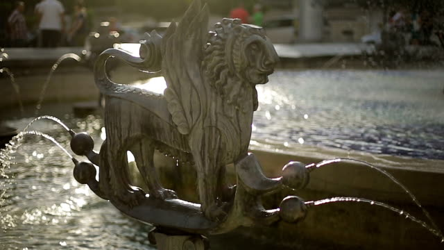 Fountain with mythical zodiac sculpture, relaxation on hot day, water streaming video
