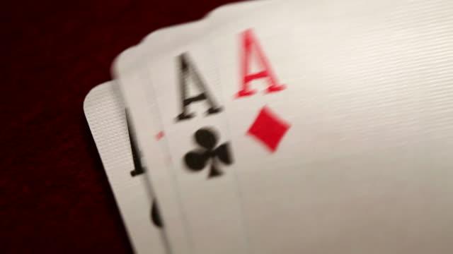 quattro assi - simbolo concettuale video stock e b–roll