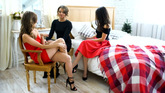four beautiful girls have gossip talks while sitting on bed women having fun laugh in bedroom. - bachelorette party stock videos and b-roll footage
