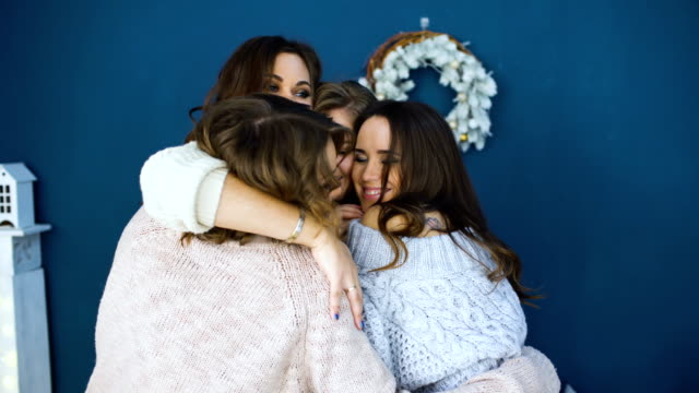 four beautiful girls hug each other . girlfriends having fun and laugh in bedroom - bachelorette party stock videos and b-roll footage