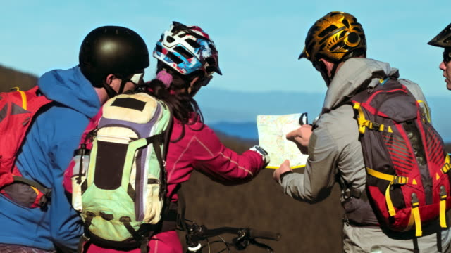 Four bikers deciding which route to take with bikes video
