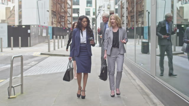 four business people commuting to work - business suit stock videos & royalty-free footage