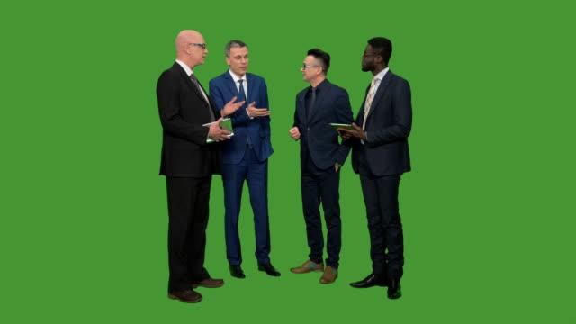 Four businessmen having conversation
