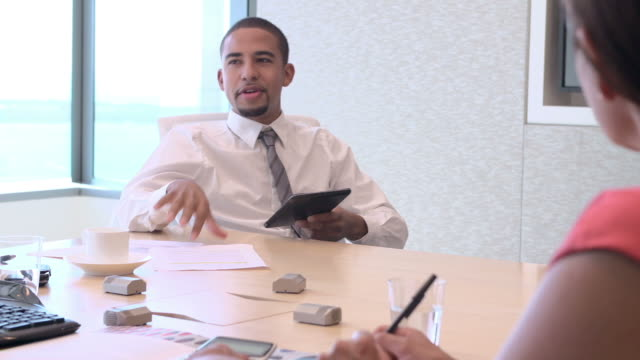 Four Businesspeople Having Meeting Around Boardroom Table video