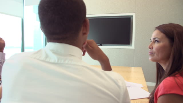 Four Businesspeople Having Video Conference In Boardroom video