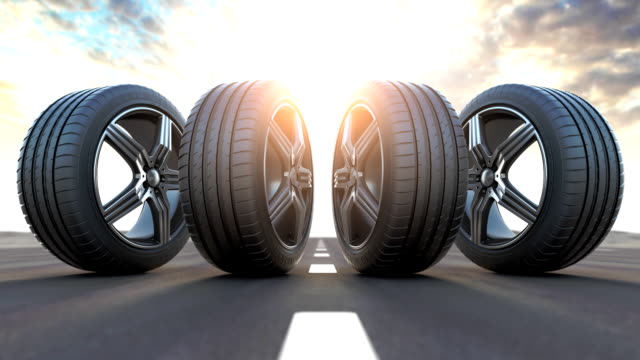 Four car wheels on the road.  Auto service, workshop or changing car tyres concept. 3d animation