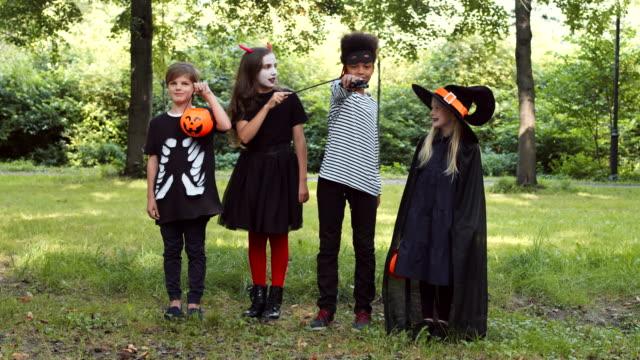 four children in halloween costumes - four seasons filmów i materiałów b-roll