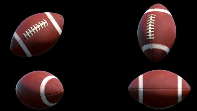 vídeos de stock e filmes b-roll de quatro diferentes rotações de bolas de futebol americano - bola