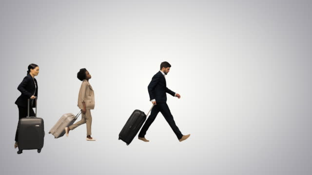 Four diverse business people with luggage checking info board being late for the train or plane on gradient background
