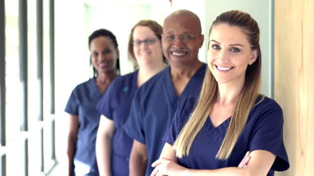 four doctors or nurses working in hospital - nurse stock videos & royalty-free footage