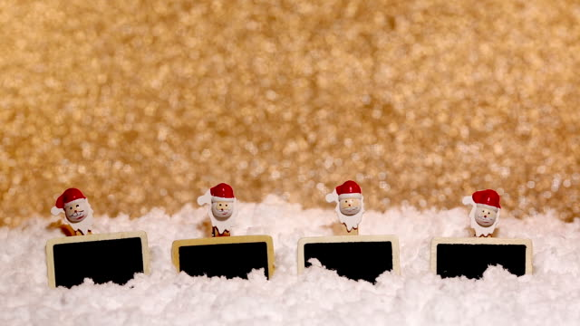 four empty christmas slates in the snow on defocused background video