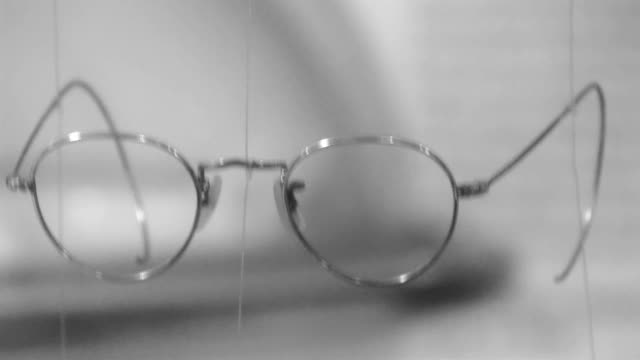Four eyeglasses hanging on a string video