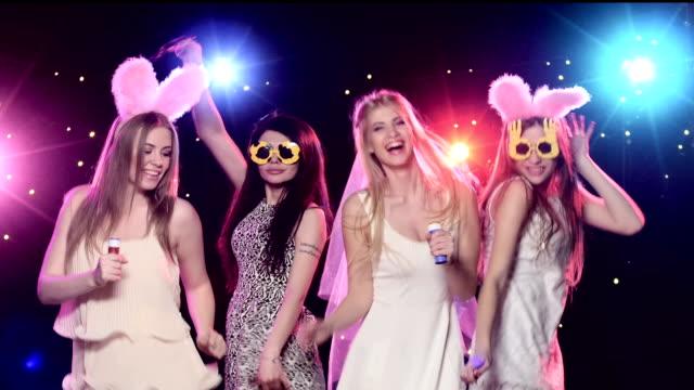 Four girls having fun at bachelorette party blowing soap bubbles video
