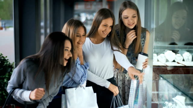 Four happy beautiful women shopping and looking at storefronts Four happy beautiful women shopping and looking at storefronts. girlfriend stock videos & royalty-free footage