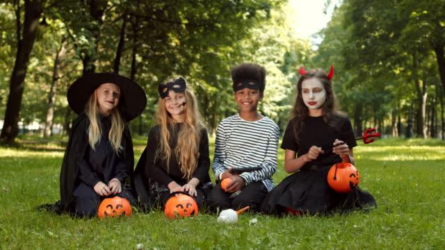four happy children on halloween - four seasons filmów i materiałów b-roll