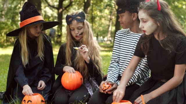 four kids after trick-or-treating - four seasons filmów i materiałów b-roll