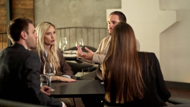 Four people argue in the restaurant Four people argue in the restaurant arguing stock videos & royalty-free footage