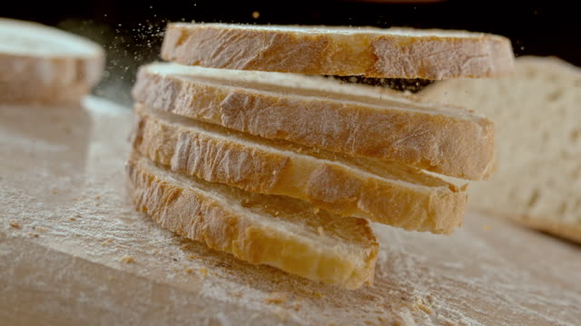 SLO MO LD Four slices of bread falling on the table