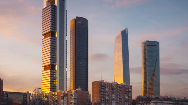 four sunset towers Timelapse of Cuatro Torres bussines area at sunset. Madrid, Spain. sorpresa stock videos & royalty-free footage