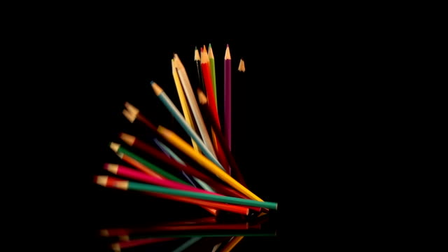Four videos of falling crayons in real slow motion video