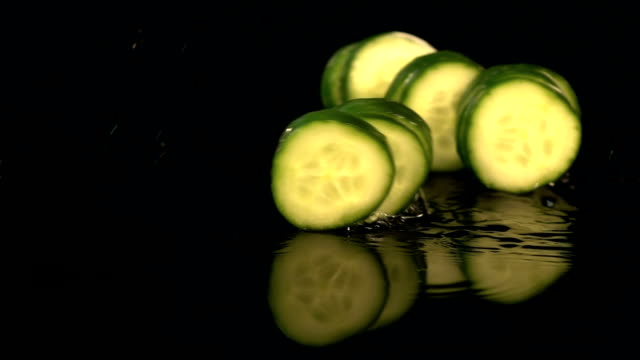 Four videos of falling cucumber in real slow motion Four high quality video of falling fresh cucumber in real 1080p slow motion pickle stock videos & royalty-free footage
