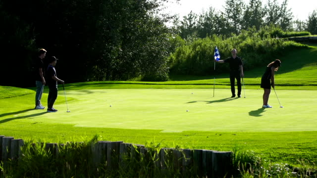 Foursome play golf video