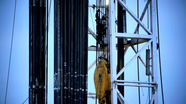 Fracking Rig Climbing Worker video