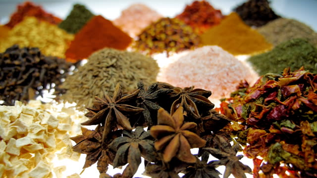 Fragrant, aromatic, natural and good for health, spices lie on the table. Macro Fragrant, aromatic, natural and good for health, spices lie on the table, separately from each other. Closeup. Dolly shot. Shallow depth of field spice stock videos & royalty-free footage