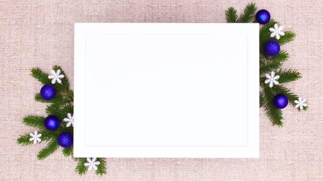 rahmen für weihnachtstext mit kiefernzweigen und blauen weihnachtsschmuck. stop-bewegung - kieferngewächse stock-videos und b-roll-filmmaterial
