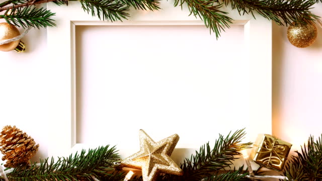 frame photo, pine branches, light and christmas decoration for new year and christmas concept background - cena di natale video stock e b–roll