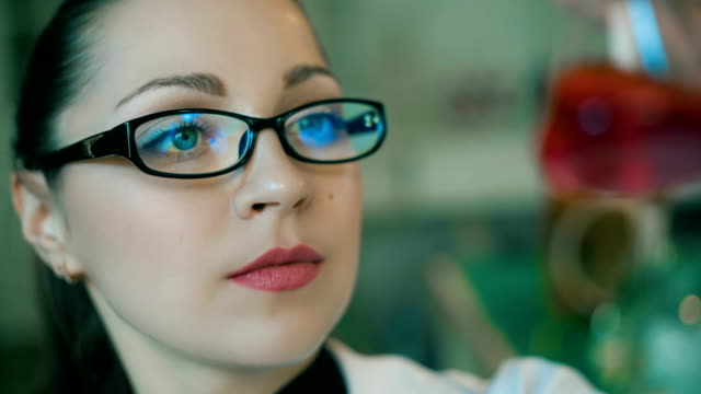 frames of a woman working in a laboratory - reagente video stock e b–roll