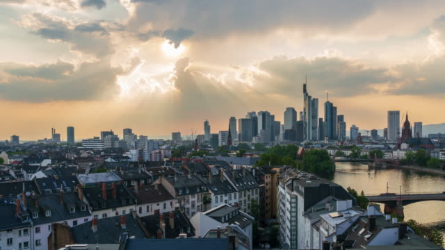 Frankfurt am Main skyline with sunray through cloud sky - 4k time lapse