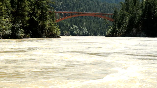 Fraser Canyon Highway Bridge and River The Alexandra Bridge, part of the Trans Canada Highway, crosses over the fast flowing Fraser River in the Fraser Canyon north of the town of Hope, BC, Canada.  fraser river stock videos & royalty-free footage