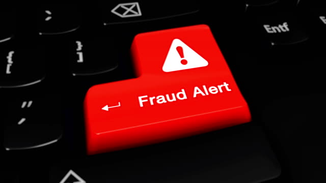 fraud alert round motion on computer keyboard button. - fraud stock videos & royalty-free footage