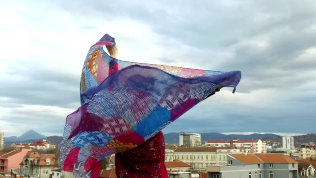 Free strong woman looking at cityscape at mountain bottom video