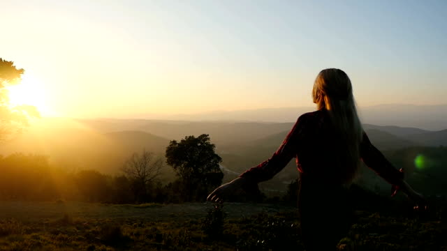 free woman open arms to sunset and spin - spirituality stock videos & royalty-free footage