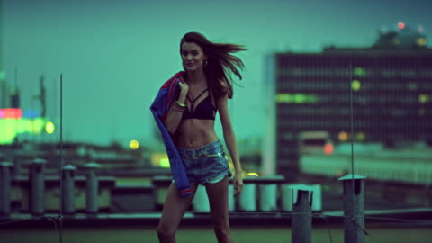 Freedom in big city Model posing.  Big city in the background. Color grading professionaly done. Shoots with RED EPIC CAMERA. 5K resolution available. high up stock videos & royalty-free footage