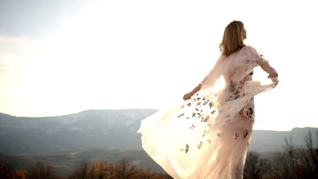 Freedom in nature Young boho girl dancing in the meadow,spinning around in white floral dress floral pattern stock videos & royalty-free footage