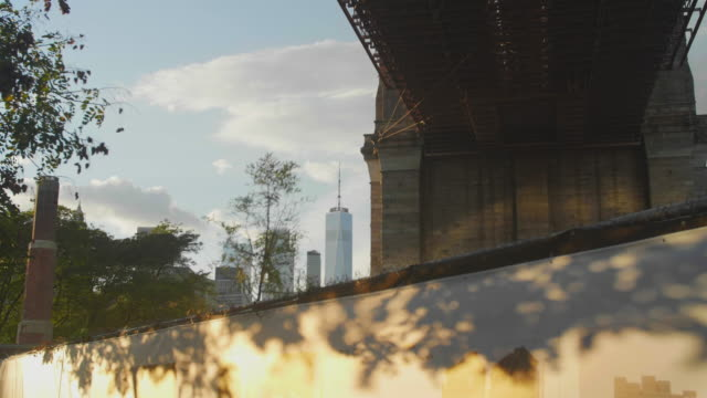 Freedom tower peeks out behind Brooklyn Bridge