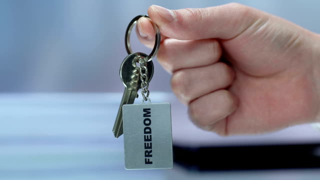 freedom word on keychain, woman taking key, female rights protection, choice - key ring stock videos & royalty-free footage