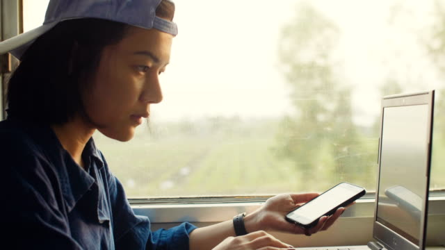 Freelance Photographer Using Laptop While Traveling By Train video