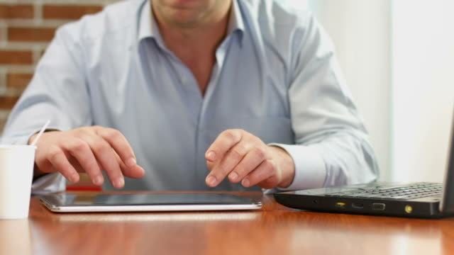 Freelance worker hands typing, sending e-mail from tablet PC video