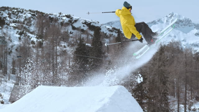 slo mo ts freestyle skier performing a jump - sci freestyle video stock e b–roll