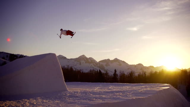 Freestyle skier performing a trick at sunset video