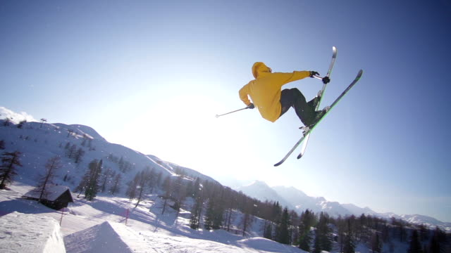 Freestyle skier performing a trick in a snow park video