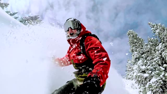 tw freestyle snowboarder in the wilderness on beautiful day - snowboarding video stock e b–roll